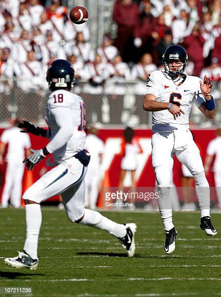 Quarterback Marc Verica of the Virginia Cavaliers throws the ball to wide receiver Kris Burd of the Virginia Cavaliers against the Virginia Tech...