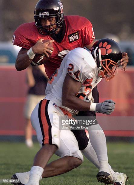 CSUN quarterback Marcus Brady makes contact with Idaho State's Joshua Robinson on a run during Saturday game September 30 2000