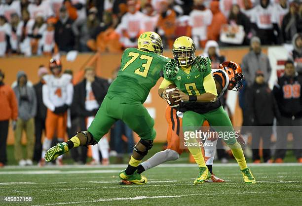Quarterback Marcus Mariota of the Oregon Ducks during the game against the Oregon State Beavers at Reser Stadium on November 29 2014 in Corvallis...