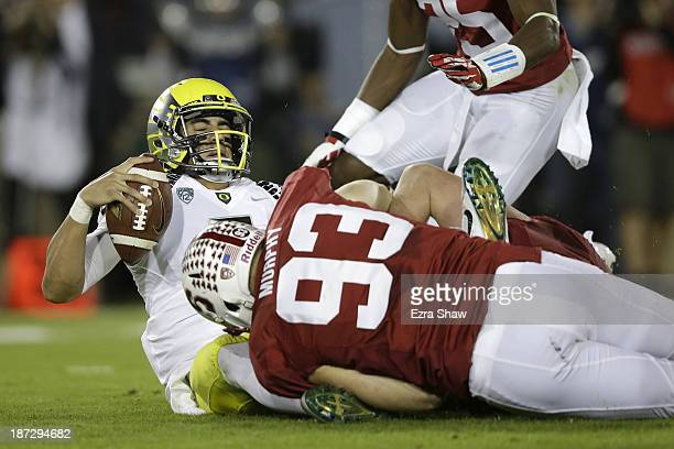 Quarterback Marcus Mariota of the Oregon Ducks is sacked by linebacker Trent Murphy of the Stanford Cardinal in the first quarter at Stanford Stadium...