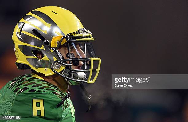 Quarterback Marcus Mariota of the Oregon Ducks looks on from the bench during the third quarter of the game against the Oregon State Beavers at Reser...