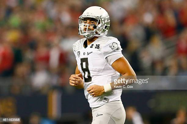 Quarterback Marcus Mariota of the Oregon Ducks looks on in the first half against the Ohio State Buckeyes during the College Football Playoff...