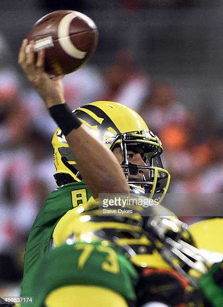Quarterback Marcus Mariota of the Oregon Ducks passes the ball during the third quarter of the game against the Oregon State Beavers at Reser Stadium...