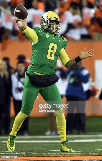 Quarterback Marcus Mariota of the Oregon Ducks passes the ball during the fourth quarter of the game against the Oregon State Beavers at Reser...