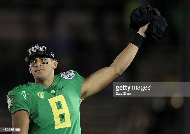 Quarterback Marcus Mariota of the Oregon Ducks reacts after defeating the Florida State Seminoles 5920 in the College Football Playoff Semifinal at...