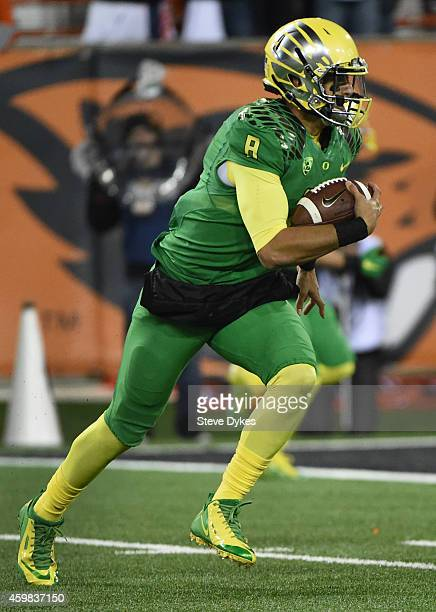 Quarterback Marcus Mariota of the Oregon Ducks runs for a touchdown during the third quarter of the game against the Oregon State Beavers at Reser...