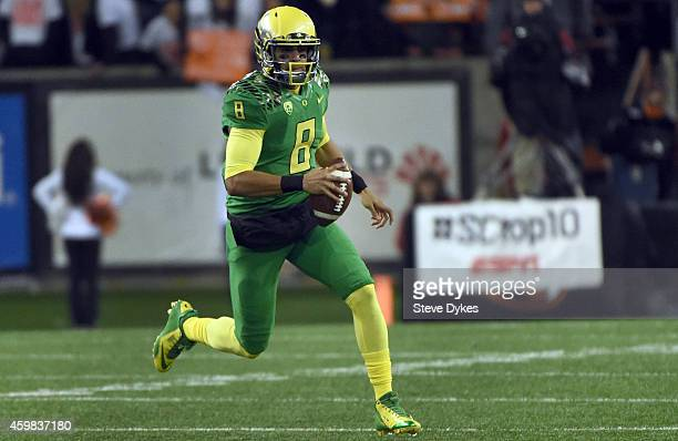 Quarterback Marcus Mariota of the Oregon Ducks runs with the ball during the fourth quarter of the game against the Oregon State Beavers at Reser...