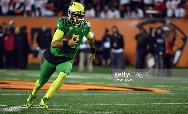 Quarterback Marcus Mariota of the Oregon Ducks runs with the ball during the third quarter of the game against the Oregon State Beavers at Reser...