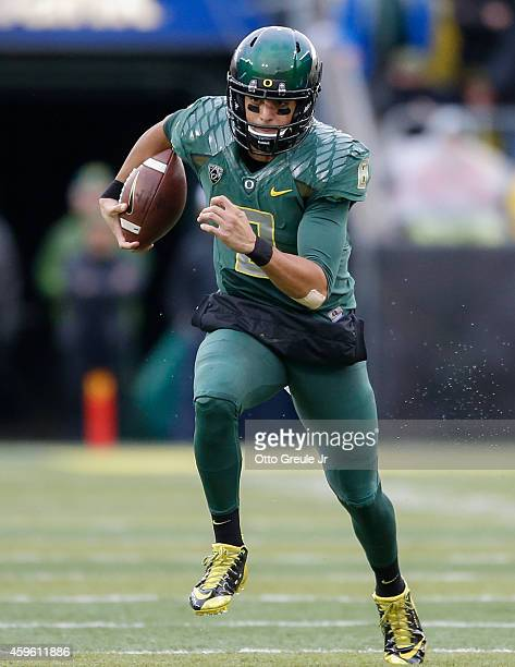 Quarterback Marcus Mariota of the Oregon Ducks rushes for a touchdown in the first quarter against the Colorado Buffaloes at Autzen Stadium on...