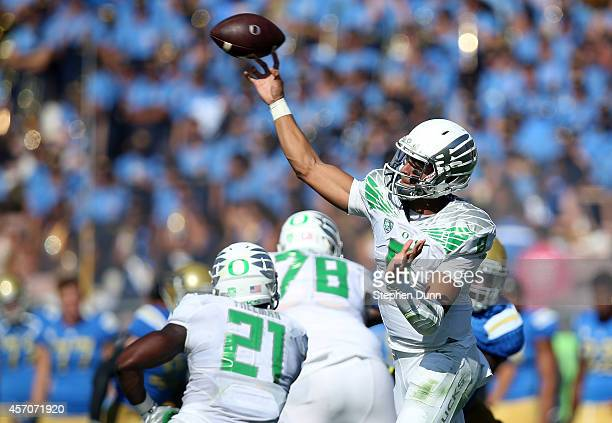 Quarterback Marcus Mariota of the Oregon Ducks throws a pass against the UCLA Bruins at the Rose Bowl on October 11 2014 in Pasadena California...