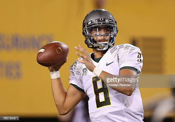 Quarterback Marcus Mariota of the Oregon Ducks throws a pass during the college football game against the Arizona State Sun Devils at Sun Devil...