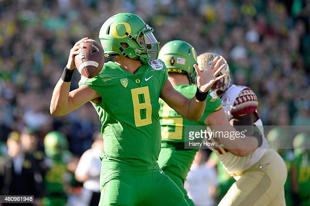 Quarterback Marcus Mariota of the Oregon Ducks throws the ball in the first quarter against the Florida State Seminoles during the College Football...