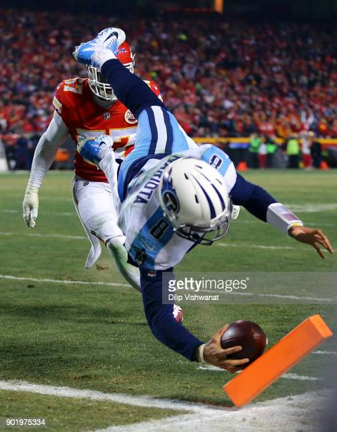 Quarterback Marcus Mariota of the Tennessee Titans dives for the end zone to score a touchdown during the AFC Wild Card playoff game against the...