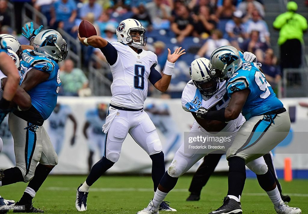 Quarterback Marcus Mariota #8 of the Tennessee Titans drops back to pass against the Carolina Panthers during the first half at Nissan Stadium on August 20, 2016 in Nashville, Tennessee.