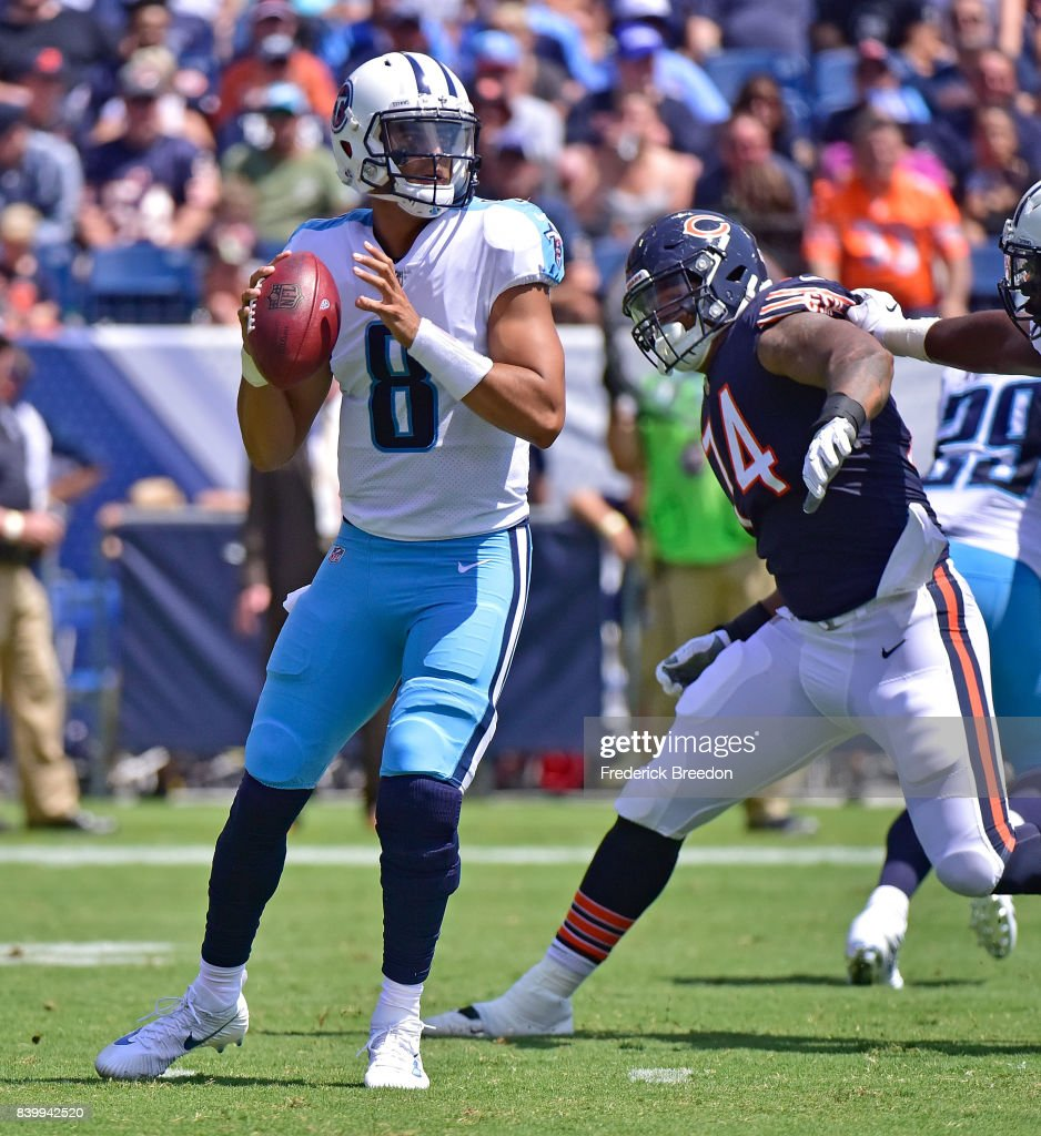 Quarterback Marcus Mariota #8 of the Tennessee Titans drops back to pass against Roy Robertson-Harris #74 of the Chicago Bears during the first half at Nissan Stadium on August 27, 2017 in Nashville, Tennessee.