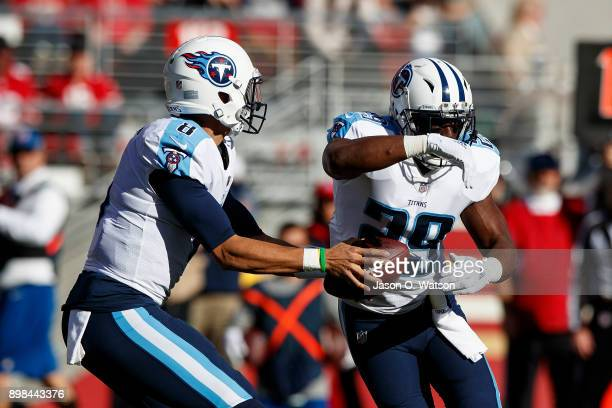 Quarterback Marcus Mariota of the Tennessee Titans fakes a hand off to Jaquiski Tartt during the first quarter against the San Francisco 49ers at...