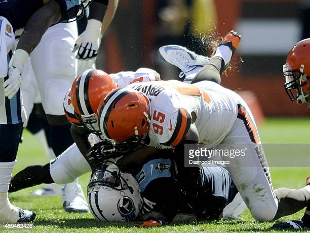 Quarterback Marcus Mariota of the Tennessee Titans is sacked by safety Donte Whitner and defensive end Armonty Bryant of the Cleveland Browns during...
