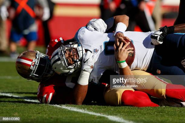 Quarterback Marcus Mariota of the Tennessee Titans is sacked by defensive tackle DeForest Buckner of the San Francisco 49ers during the first quarter...