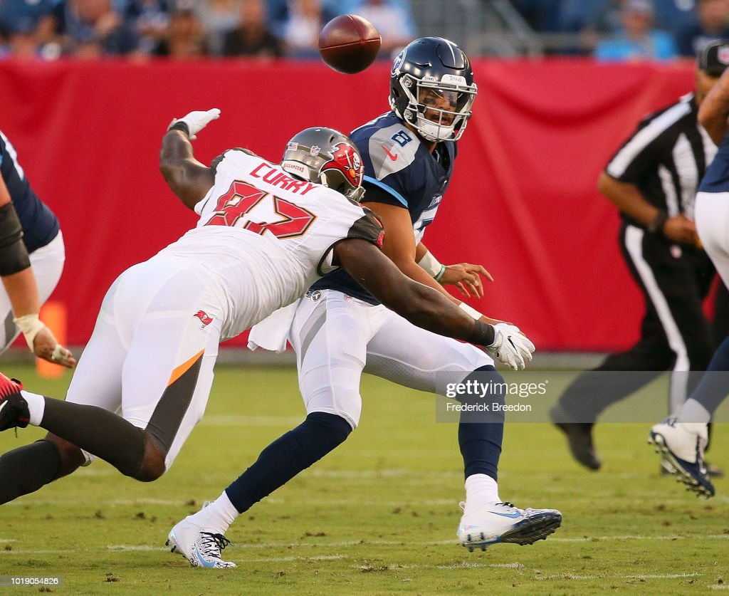 Quarterback Marcus Mariota #8 of the Tennessee Titans pitches the ball over Vinny Curry #97 of the Tampa Bay Buccaneers during the first half of a pre-season game at Nissan Stadium on August 18, 2018 in Nashville, Tennessee.