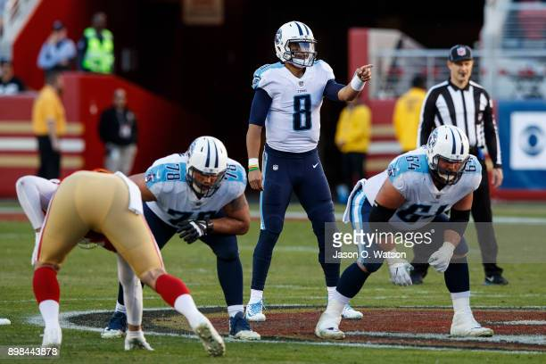Quarterback Marcus Mariota of the Tennessee Titans signals behind the line of scrimmage against the San Francisco 49ers during the third quarter at...