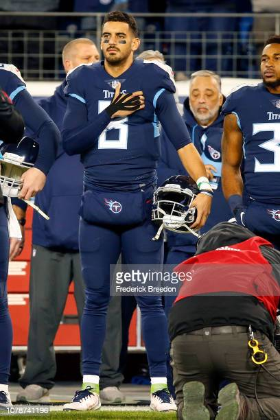 Quarterback Marcus Mariota of the Tennessee Titans stands for the national anthem prior to a game against the Jacksonville Jaguars at Nissan Stadium...