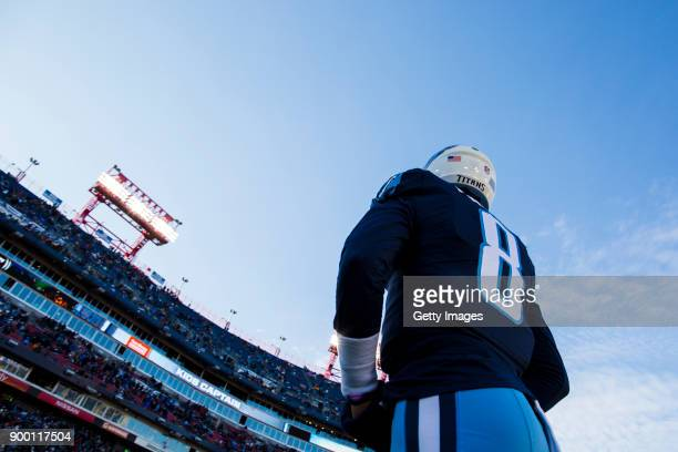 Quarterback Marcus Mariota of the Tennessee Titans walks back to his bench following a coin toss against Jacksonville Jaguars at Nissan Stadium on...
