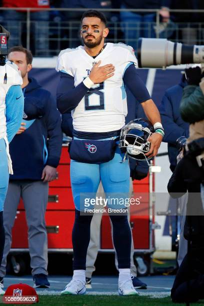 Quarterback Marcus Mariota stands during the national anthem prior to a game against the Washington Redskins at Nissan Stadium on December 22 2018 in...