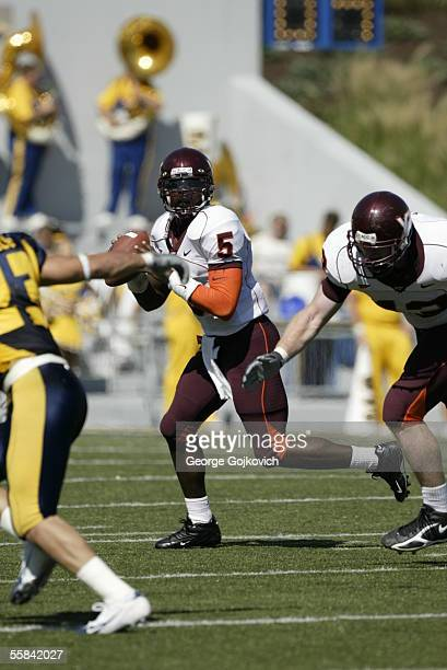 Quarterback Marcus Vick of the Virginia Tech Hokies looks to pass against the West Virginia University Mountaineers at Milan Puskar Stadium the home...