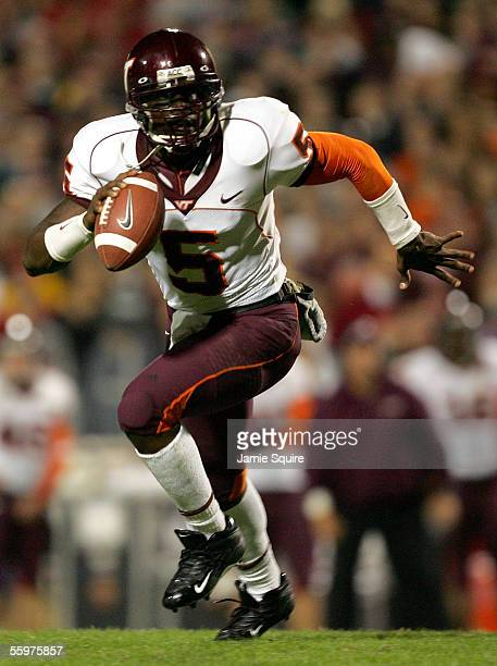 Quarterback Marcus Vick of the Virginia Tech Hokies scrambles with the ball during the first half of the game against the Maryland Terrapins on...