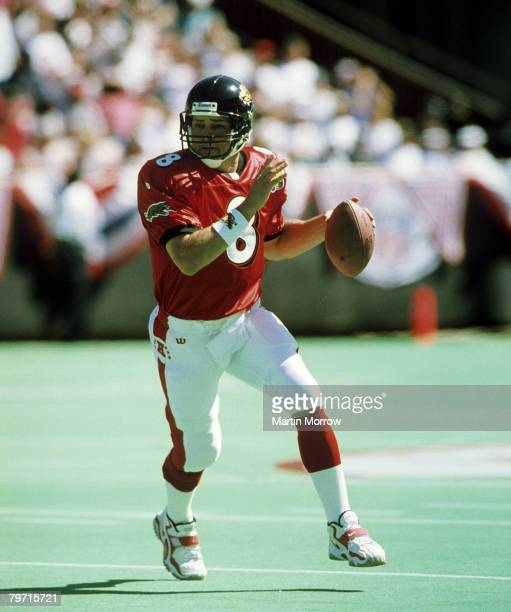 AFC quarterback Mark Brunell of the Jacksonville Jaguars rolls out and looks for an open receiver during the AFC's 2924 victory over the NFC in the...