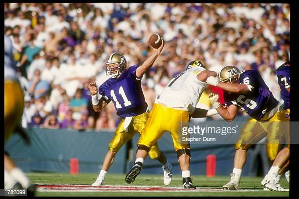 3f8e364ea Quarterback Mark Brunell of the Washington Huskies passes the ball during  the Rose Bowl against the