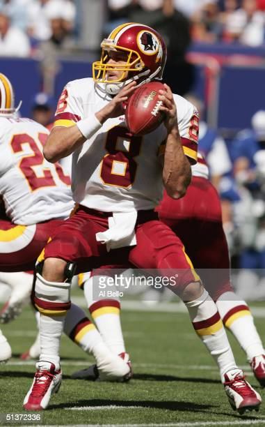 Quarterback Mark Brunell of the Washington Redskins drops back to pass against the New York Giants on September 19 2004 at Giants Stadium in East...