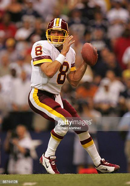 Quarterback Mark Brunell of the Washington Redskins drops back to pass against the Dallas Cowboys on September 19 2005 at Texas Stadium in Irving...