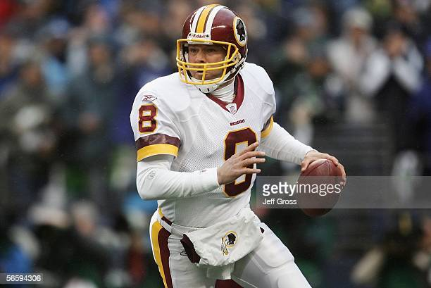 Quarterback Mark Brunell of the Washington Redskins scrambles with the ball against the Seattle Seahawks during the NFC Divisional Playoff game on...