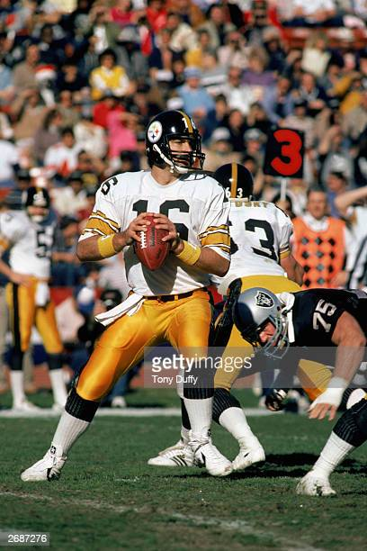 Quarterback Mark Malone of the Pittsburgh Steelers finds a receiver during a 1984 NFL game against the Oakland Raiders at the Oakland Coliseum in...
