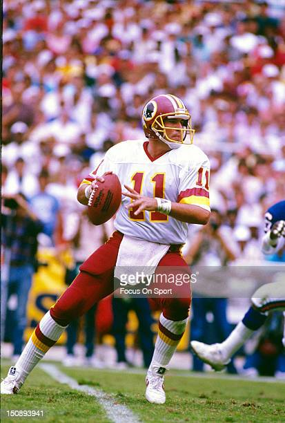 Quarterback Mark Rypien of the Washington Redskins drops back to pass against the New York Giants during an NFL football game at RFK Stadium October...