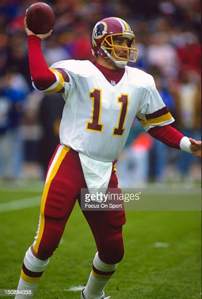 Quarterback Mark Rypien of the Washington Redskins drops back to pass against the Phoenix Cardinals during an NFL football game at RFK Stadium...