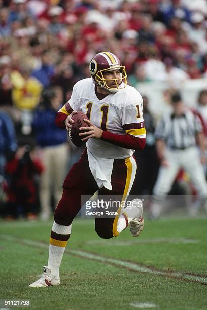 Quarterback Mark Rypien of the Washington Redskins drops back to pass during the 1990 NFC Divisional Playoffs against the San Francisco 49ers at...