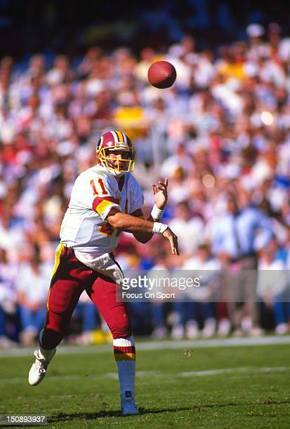 Quarterback Mark Rypien of the Washington Redskins throws a pass against the Phoenix Cardinals during an NFL football game at RFK Stadium October 16...