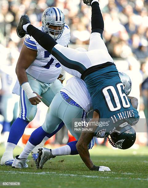 Quarterback Mark Sanchez of the Dallas Cowboys is sacked by Marcus Smith II of the Philadelphia Eagles during the second quarter of a game at Lincoln...