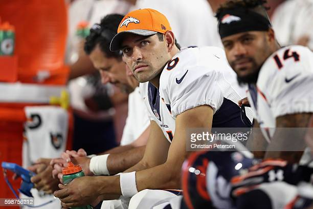 Quarterback Mark Sanchez of the Denver Broncos watches from the sidelines during the preseaon NFL game against the Arizona Cardinals at the...