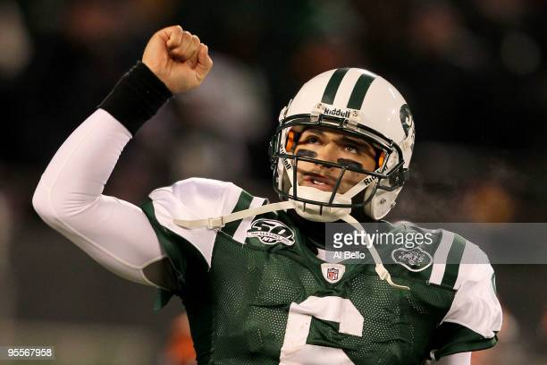 Quarterback Mark Sanchez of the New York Jets celebrates a touchdown by Thomas Jones in the fourth quarter of the game against the Cincinnati Bengals...