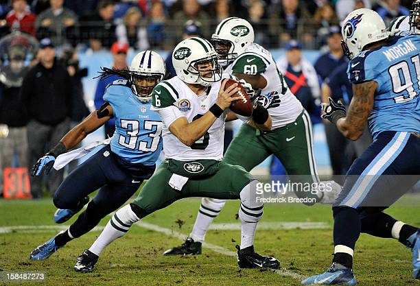 Quarterback Mark Sanchez of the New York Jets is pressured by Michael Griffin of the Tennessee Titans at LP Field on December 17 2012 in Nashville...