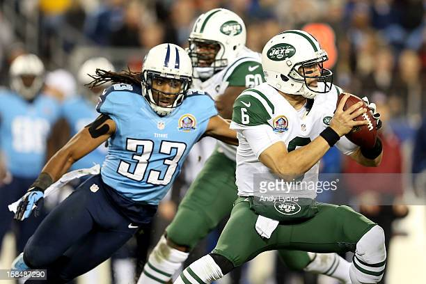 Quarterback Mark Sanchez of the New York Jets looks to throw the ball against free safety Michael Griffin of the Tennessee Titans at LP Field on...