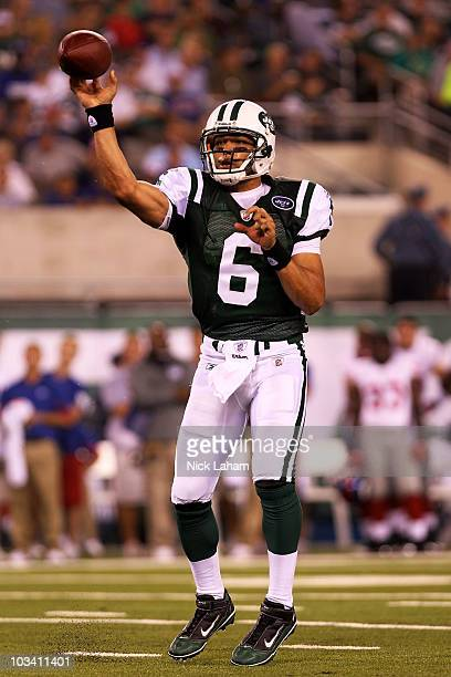 Quarterback Mark Sanchez of the New York Jets passes against the New York Giants during their game at New Meadowlands Stadium on August 16 2010 in...