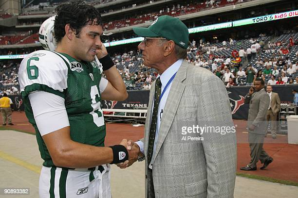 Quarterback Mark Sanchez of the New York Jets receives a pep talk from Hall of Fame Quarterback Joe Namath of the New York Jets before the game...