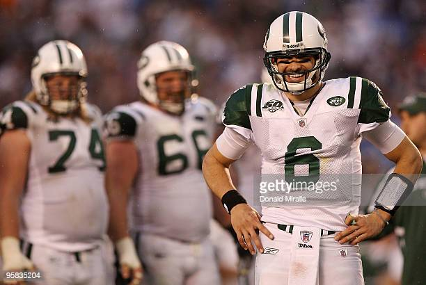 Quarterback Mark Sanchez of the New York Jets smiles on the field in the final moments of the AFC Divisional Playoff Game against the San Diego...