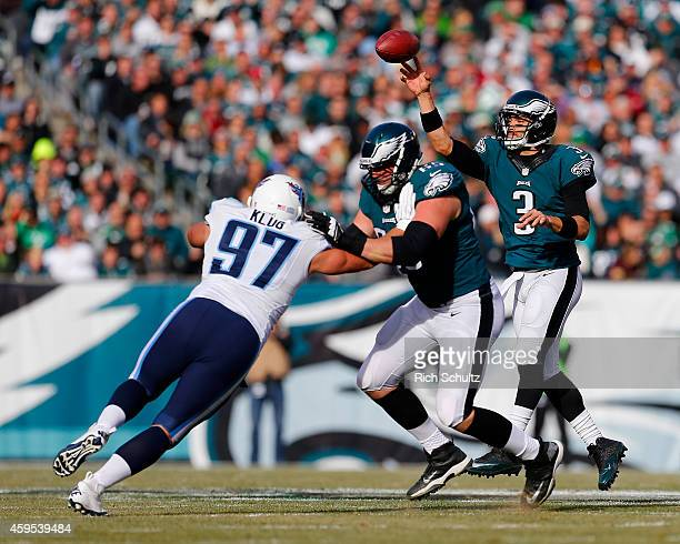 Quarterback Mark Sanchez of the Philadelphia Eagles gets off a pass as teammate Lane Johnson blocks Karl Klug of the Tennessee Titans in the second...