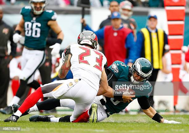 Quarterback Mark Sanchez of the Philadelphia Eagles runs the ball for a first down against Chris Conte of the Tampa Bay Buccaneers in the first...