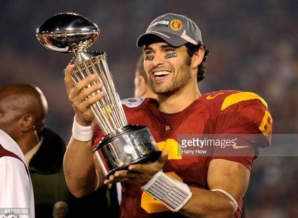 Quarterback Mark Sanchez of the USC Trojans celebrates with the trophy after defeating the Penn State Nittany Lions at the 95th Rose Bowl Game...